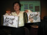 Daphne holding two versions of VGA Apogee box during the vote